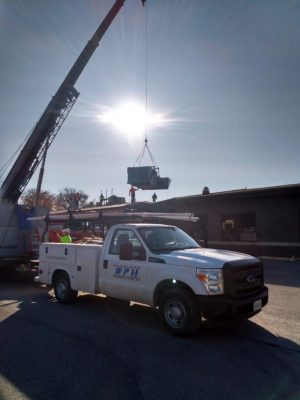 Rooftop unit install with crane.